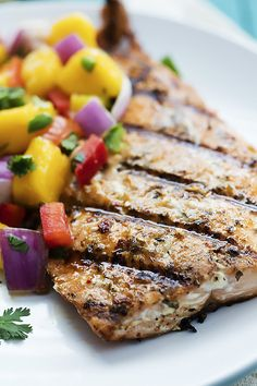 Grilled Salmon with Mango Salsa - perfectly grilled flaky pink salmon topped with sweet and spicy mango salsa.