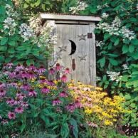 An old outhouse, bought at a fair flea market, serves as both a storage shed and a decorative object in this yard. Patio, Backyard, Tall Ornamental Grasses, Garden Photos, Yard Art, Dried Flowers, Garden Tools, Garden Sheds, Outdoor Gardens