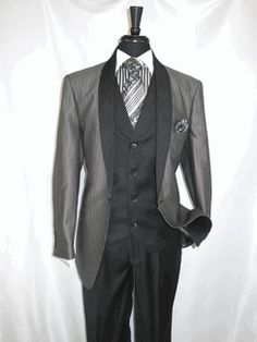 """E.J.Samuel #M2697 """"Black-White"""" Vested Men's Suit (one) button Single Breasted Suit Jacket in """"Pin Stripe File Fabric"""" Shawl Label with 2 Flap Pockets and side vented for style.The Vest is single Breasted also a Shawl Lapel and 2 besom Pockets with """"Banker Strap"""" back available for $229.99 @ BerganBrothersSuits.com"""