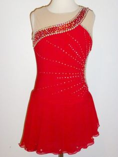 Pretty figure skating dress with one shoulder look and pretty crystal pattern.