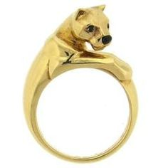 18k yellow gold panther ring, crafted by Cartier for Panthere collection, decorated with black onyx nose and emerald eyes. DESIGNER: Cartier MATERIAL: 18K Gold GEMSTONE: Emerald, Onyx RING: STYLE Ring