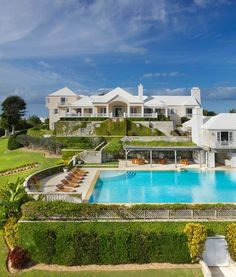 Graced with an impressive provenance and located just minutes from Hamilton, this grandly proportioned 14-acre Bermuda beachfront estate was the subject of a carefully orchestrated three-year renovation by a world-class team of international architects, builders, and craftsmen.