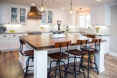 This wood floor with wood butcher block looks great! Light grey and white countertops?