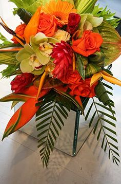Love the burst of colors and modern feel of these florals against a zebra print