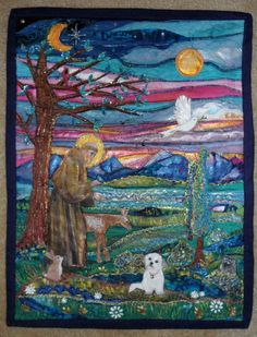 Saint Frrancis - a wall hanging by Jean Batzell Fitzgerald with 65+ pieces of fabric, hand painting added.  Www.saintfrancisgifts.com   Lots of breeds with St. Francis on 50+ products.