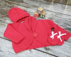 Bright red outfit that comes with a super cozy cozy cardigan with mittens and a hat. months Material: bamboo and wool Washing/drying instruction: Hand wash and lay flat to dry. Baby Mittens, Red Cardigan, New Moms, Baby Shower Gifts, Cozy, Hat, Trending Outfits, Unique Jewelry, Handmade Gifts