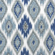 A multipurpose ikat cotton fabric in indigo blue, silver grey and denim blue on a white background. This durable home decor fabric is suitable