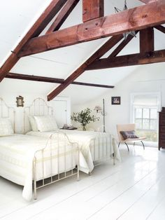 via Hamptons Cottage and Gardens = love to do an attic guest room for kids!