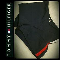 Tommy Hilfiger Swim Shorts Tommy Hilfiger Signature Swim Shorts in Dark Navy Shade, Blocks of Red & White Tommy Design! 100% Nylon, Front Zipper with Snap Button Closure, Used in Mint Condition! Tommy Hilfiger Shorts