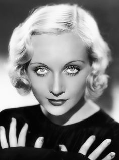 Carole Lombard, 1933. A smokey blonde/ very smart intelligent women who was always showing off her sexuality differently i.e covered up clothes, wasn't the type of sexy symbol who expressed a lot of flesh.