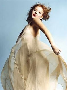 Renee Olstead on singing and dancing in the air photo shoot session.