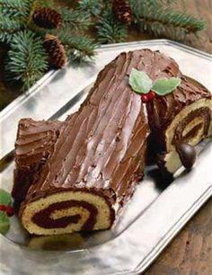 The first Christmas yule log cake, or Buche de Noel, recipe was cleverly created in the late 1800s by a French pastry chef looking to replace and pay culinary homage to the original yule log tradition. This new, gastronomic tradition caught on in spectacular fashion, and the Christmas dessert is now celebrated worldwide. This chocolate buche de Noel recipe showcases a light-as-air, vanilla Genoise cake rolled into a cylinder with the richest, homemade chocolate buttercream frosting.