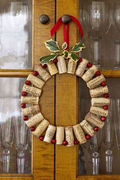 Save the evidence of a holiday party for this recycled wreath. Strung together between red jingle bells, wine corks add a festive note to the dining room. Click through for the tutorial and more DIY Christmas wreaths.