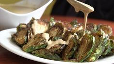 Brussels Sprouts With Pomegranate-Tahini Sauce by Julia Moskin