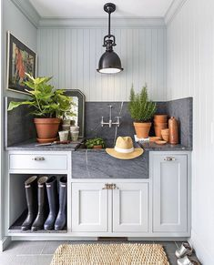 Vertical wall paneling + mudroom + mudroom ideas + shoe storage ideas + sink in mudroom + mudroom storage + jute rug + rain boots + indoor greenery + lantern lighting + vertical shiplap + slate countertop Custom Home Builders, Kitchen, Home, Custom Homes, Mud Room Storage, Kitchen Remodel, Laundry Room Decor, Farmhouse Kitchen, Mudroom Design