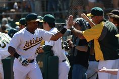 CrowdCam Hot Shot: Oakland Athletics designated hitter Yoenis Cespedes is congratulated for hitting a two-run home run against the Los Angeles Angels during the third inning at O.co Coliseum. Photo by Kyle Terada