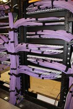 An exemplary example of rear cable routing and management by Inflectiontech on a Hubbell NextFrame rack