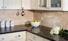 kitchen subway tile backsplash ideas - very similar to current backsplash but not the black countertops
