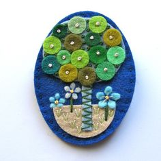 Tree felt brooch with freeform embroidery by designedbyjane
