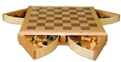 "Jessica 13"" Wooden Chess Set with Revolving Chambers by Best Chess Set. $44.95. board square size: 1.5 in.. unique design. king's height: 2.5 in.. board type: inlaid wood. set dimensions: 13x13x2.5 in.. Chess is a recreational and competitive game played between two players. Sometimes called Western chess or international chess to distinguish it from its predecessors and other chess variants, the current form of the game emerged in Southern Europe during the second half of the ..."