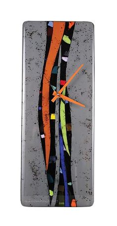 Created by Nina Cambron  Undulating strips of gray interplay with burnt orange, chartreuse and a myriad of colored glass chards 16.5in H x 6.5in W x 1.5in D $199