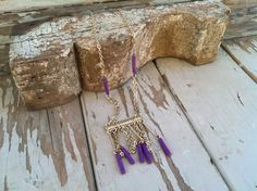 Check out this item in my Etsy shop https://www.etsy.com/listing/186593036/retro-purple-necklace-purple-gold-fringe