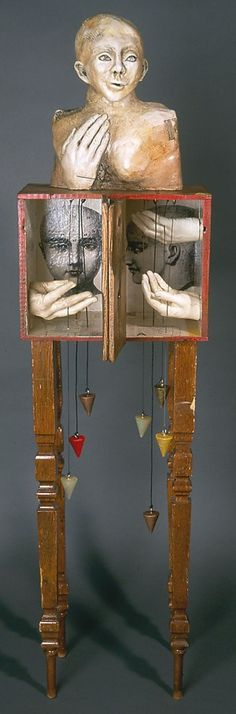 Interesting. Always love hands and feet imagery. Love the boxes and the freedom of the hanging parts. www.janetoneal.com