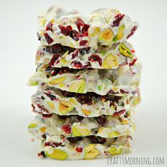 Here is the recipe to make christmas bark using dried cranberries, pistachios, and white chocolate! It's an easy recipe for holiday parties.