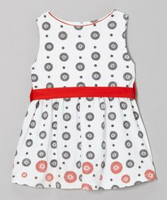 Dainty features bring a whole new level of pretty to a little one's wardrobe. All snuggles in dreamy soft organic cotton, this frock is an adorable first step into the wide world of fashion.