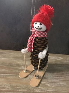 Styrofoam balls, egg candy canes, toothpicks, crocheted hats, done . Pine Cone Christmas Decorations, Christmas Ornament Crafts, Snowman Crafts, Christmas Crafts For Kids, Christmas Projects, Kids Christmas, Holiday Crafts, Pine Cone Crafts, Crocheted Hats