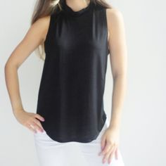 • SALE • Gemma Mock Neck Top Sleeveless, solid black mock/high neck top. Perfect staple piece as it can be worn with a variety of clothing. 95% Rayon, 5% Spandex. *Modeling size Small*  ☑️ NO trades. Price is FIRM unless bundled. ☑️ Sizes Available: Small (ONE left), Medium, and Large (ONE left). Tops Tank Tops