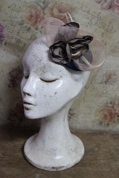 This piece is elegant, romantic and beautiful headpiece. It is a fascinator perfect for a special occasion like to winter formal event,