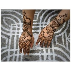 "Beauty donning henna ""armor"" over a wedding rangoli design. Both by M. Buhler-Rose of Mehndi NYC."