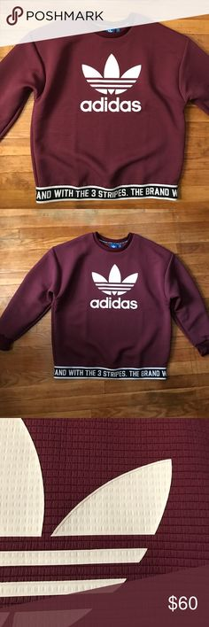 Unique Adidas Crew Neck This crew neck/pullover is extremely comfortable. It has a really nice texture and the bottom band is really unique. It's a very nice burgundy/wine color. It's also new without tags!! Offers are welcome  Adidas Tops Sweatshirts & Hoodies