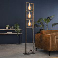 The floor lamp is a rectangular model with three light sources. It has an industrial tough vintage look, it will suit in any interior placed and brings ambiance! Retro Floor Lamps, Industrial Floor Lamps, Wooden Floor Lamps, Corner Floor Lamp, Star Lamp, Wall Lights, Ceiling Lights, Flooring Sale, Wooden Tops