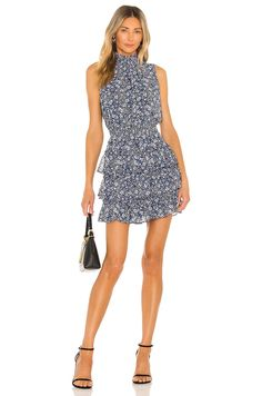 A high neckline, cinched waist, and ruffled bottom make this floral dress so flattering. For a more casual rehearsal dinner, try it with wedges or booties, or dress it up with heels and a pretty clutch. #weddingguestdress #weddingguestoutfit #rehearsaldinnerdress #dressestoweartoawedding #southernliving Dress Like A Parisian, Parisian Style, Halter Neck Maxi Dress, Ruffle Dress, Rehearsal Dinner Dresses, Dress With Sneakers, Mini Dress With Sleeves, Buy Dress, Flare Dress