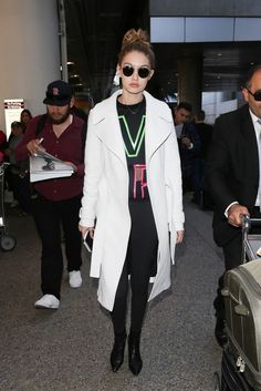 Gigi Hadid (in a Versace sweatshirt) Proves You Can Be Comfy and Chic at the Airport