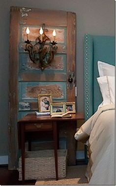 How beautiful is the door as a bedside table backdrop?  So creative!  The nailhead headboard juxtaposes nicely with the sconce and shabby door.