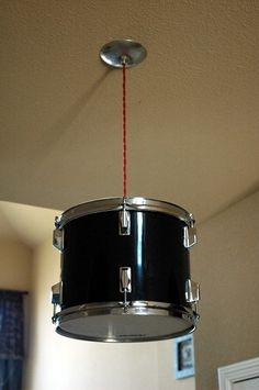#DIY drum light... you know, from an actual drum!-This would be a great for my brother to put in his home office. I <3 this! :)