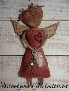 This Primitive Folk Art Valentine Angel Doll is made from grungy muslin that is coffee and  cinnamon stained, baked, painted and sanded. She