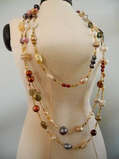 A 67 inch necklace of pearls in a variety of colors, shapes and sizes. It can be worn in a variety of ways from long and doubled to a four strand necklace. The clasp is a gold filled lobster claw. Pearl Jewelry, Wire Jewelry, Beaded Jewelry, Handmade Jewelry, Jewelry Necklaces, Diy Bridal Jewellery, Jewelry Trends, Jewelry Accessories, Jewelry Design