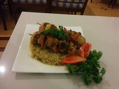 Arabian Food Shish Tawook. Grilled cubes of #chicken and #vegetables served on a bed of rice