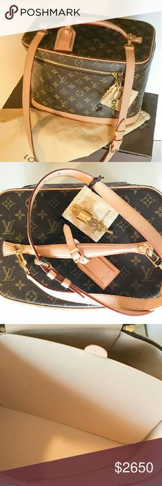 """BRAND NEW 100%Auth Louis Vuitton """"Nice"""" Makeup Bag This elegant beauty case in Monogram canvas closes with a zip. Worn on the shoulder or in the hand, it opens to reveal a mirror, zipped pocket and loops for bottles.  12.6 x 7.9 x 8.3 inches   - Monogram canvas, natural cowhide trim  - Golden brass pieces  - Double zip-around closure  - Removable adjustable leather shoulder strap  -  Lock and key. - Orig dustbag and box included.  Date code: AA0145  Not a reseller.  From Bev Hills store…"""