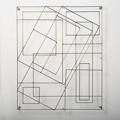 Shop Graham Wire Wall Art. Overlapping geometric shapes form minimalist sculpture that appears to float. Hang vertically or horizontally on any wall for delicate addition. CB2 exclusive.