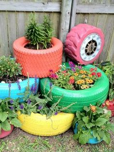 15 DIY How to Make Your Backyard Awesome: repurpose old tires and paint them bold colors to brighten your garden.