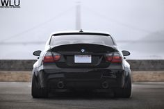 Widebodied, negative-camber dropped, dual tip exhausted, CSL trunked M3 Sedan.