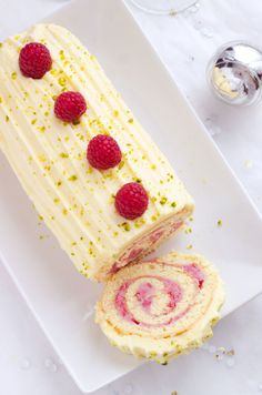 Raspberry & White Chocolate Cake Roll—Easy to make ahead and then serve at your Holiday party. This simple chocolate roll cake with spirals of creamy chocolatey raspberry ganache is the perfect...