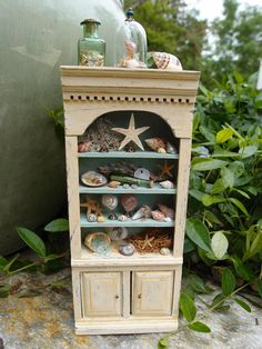 Beach House Cabinet by StudioOneTwelve on Etsy. Need a place to display my collection.