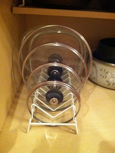 Simply Homemade: Organizing Pots and Pan Lids File rack holds all your lids next to your pans To Total organization ! Simply Homemade: Organizing Pots and Pan Lids File rack…