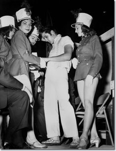 Elvis Presley signs autographs for dancers in 'Stars Over Dixie' at the Mid-South Fair Sept. 29, 1956. 'Stars over Dixie' was a Broadway extravaganza booked for the fair in honor of its centennial anniversary.